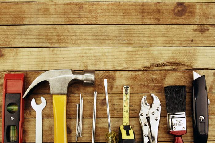 Assortment of tools on wood